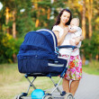 Young mother with infant baby outdoors — Stock Photo