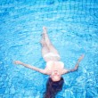 Stock Photo: Young womin swimming pool