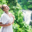 Young woman near waterfall, bali, indonesia — Stock Photo