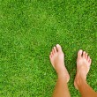Foot over green grass — Stock Photo #19926243
