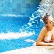 Young beautiful woman outdoors in swimming pool, bali - Stock Photo