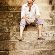 Handsome man sitting on the stairs, Bali — Foto de Stock