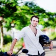Foto Stock: View of a man with a motorcycle