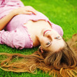 Young woman on the grass — Stock Photo