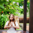Portrait of a young woman practicing yoga, bali — Stock Photo #19927209