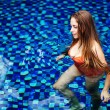 Young woman in the pool in luxury resort, Bali, Indonesia - Lizenzfreies Foto