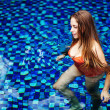 Young woman in the pool in luxury resort, Bali, Indonesia - Стоковая фотография