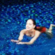 Young woman in the pool in luxury resort, Bali, Indonesia - Foto Stock