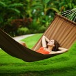 Young beautiful woman in hammock, Bali, Indonesia — Stock Photo #19927253