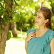 Young beautiful natural woman in the garden — Stock Photo