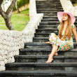 Young beautiful woman outdoors on the stairs - Photo