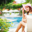 Young beautiful woman outdoors near swimming pool — Stock Photo #19927431