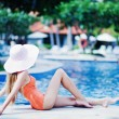 Young beautiful woman outdoors near swimming pool — Foto Stock