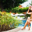 Young beautiful woman outdoors near swimming pool — Stock Photo #19927441