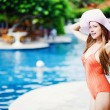 Young beautiful woman outdoors near swimming pool — Stock Photo