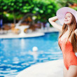 Young beautiful woman outdoors near swimming pool — Stock Photo #19927449