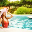 Young beautiful woman outdoors in swimming pool — Stock Photo #19927499