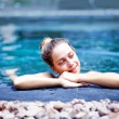 Young caucasian woman in pool — Stock Photo