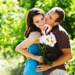 Couple with flowers — Stock Photo #19928075