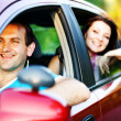Happy smiling couple in a car. Driving. - Stok fotoğraf