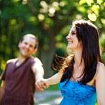 Closeup portrait of romantic young love couple in a park — Stock Photo