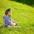 Little girl on the grass — Stock Photo #19928113