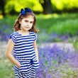 Photo: Little girl in the summer garden