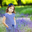 Little girl in the summer garden — Stock fotografie