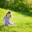 Little girl on the grass — Stock Photo #19928121