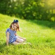 Little girl on the grass — Stock Photo