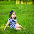 Little girl on the grass — 图库照片