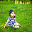 Foto de Stock  : Little girl on the grass