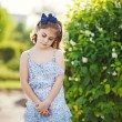 Little girl in the summer garden — 图库照片