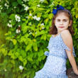 Little girl in the summer garden — Stockfoto #19928135