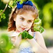Little girl in the summer garden — Stock Photo