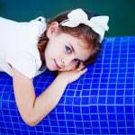 Little girl near swimming pool — Stock Photo