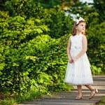Little girl in the summer garden — Stock Photo