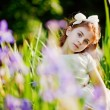 Little girl in the summer garden — Stockfoto #19928167