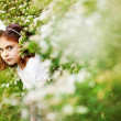 Little girl in the summer garden — Stok fotoğraf