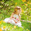 Little girl in the garden — Foto Stock