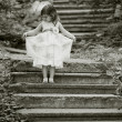 Beautiful girl on the stairs — Stok fotoğraf