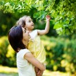 Mother with daughter in garden — Stock Photo #19928229