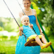 Stock Photo: Children on swing