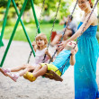 Children on swing soft focus (focus on boy's eyes) — Stock Photo