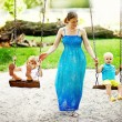 Children on swing — Stock Photo #19928289
