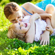 Happy woman with kid outdoors — Stock Photo
