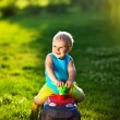 Kid with car outdoors - Stock Photo