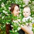 Mother and her child in spring park — Stock Photo