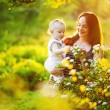 Mother and her child in spring park — Stock Photo #19929159