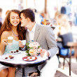 Cafe couple drinking talking having fun laughing smiling happy - Stock Photo